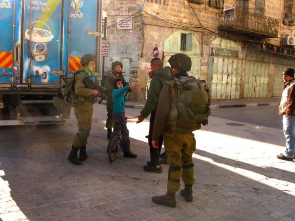 03.02.2016 Hebron H2, Bab Al Baladia, Boy detained for 4 soldiers. Photo EAPPI - M. Haglund